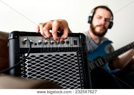 Caucasian man praticing electric guitar