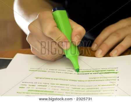 Student Using Marker To Mark Important Text