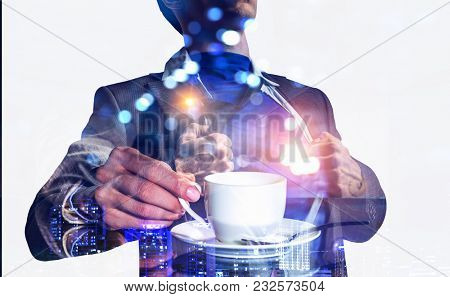 Super businessman and coffee cup