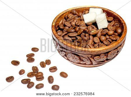 Coffee Beans With Slices Of Sugar In A Handmade Pial On A White Background With Scattered Grains.