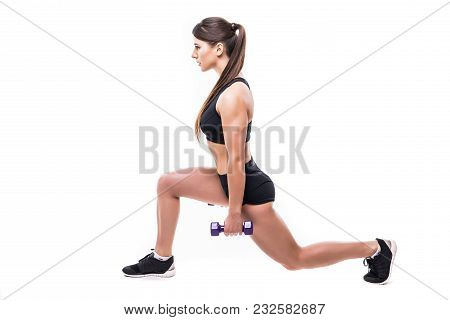 Beautiful Young Woman Doing Lunge Exercise With Red Dumbbells In Fitness Gym Isolated Over White Bac