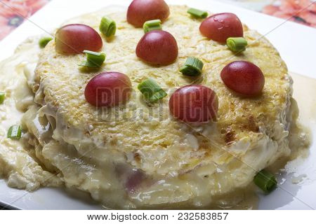 Baked Cake Made From Ham, Eggs, Cheese And Sour Cream Covered With Pieces Of Grapes