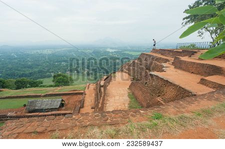 Tourist Watching Natural Landscape With Ancient Pond Of Sigiriya City, Ruins And Archeological Area