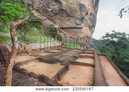 Basement Of Ancient City Palace On Sigiriya Rock And Tourists Walking Around Archeological Area. Une