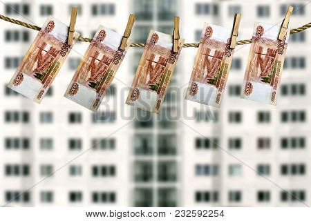 Real Estate Investment Concept. Five Thousand Russian Rouble Banknotes Hanging On A Clothesline With