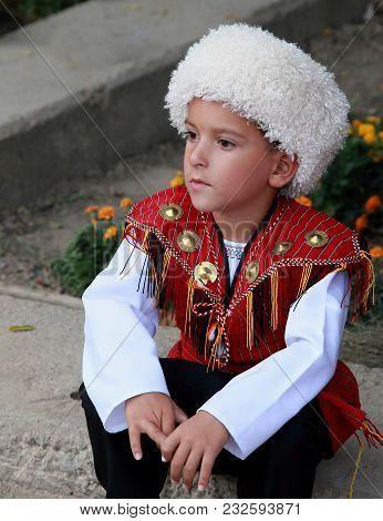 Ashgabat, Turkmenistan - September, 12, 2017.  Portrait Of  Unidentified Serious  Asian Boy.  Boy In