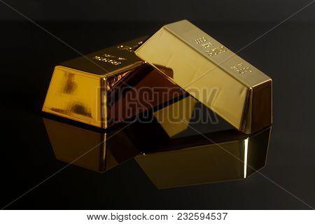 Gold Bullion Bars On A Black Background