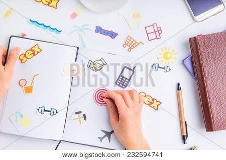 Female Hand Pinning Clerical Button On Target Icon In Personal Planning Organizer Among Other Icons