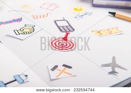 Planning Organizer With Icons Of Actions And Target With Pushpin As An Arrow On The Working Place Wi