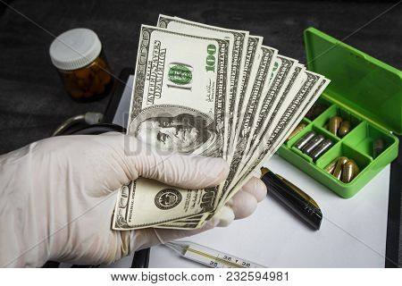A Lot Of Dollars In The Doctor's Hand
