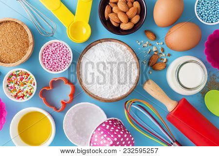 Baking Ingredients And Tools On Blue Background