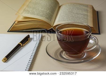 Tea, Book And Notebook On White Table