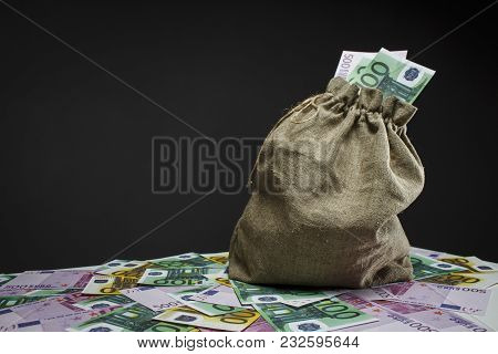 A Full Bag Of Euros On A White Table
