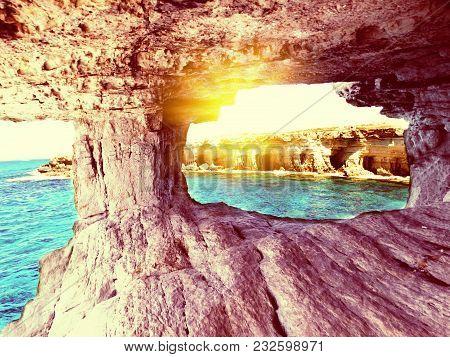 Rocky Coast In The Mediterranean Sea Caves Landscape On Cyprus Island