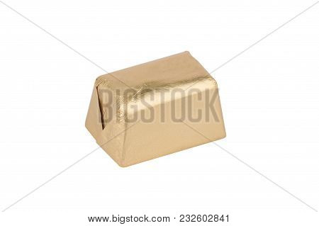 Top View Closeup Of Chocolate Candy Bar Wrapped In Golden Foil Packaging Isolated On White Backgroun