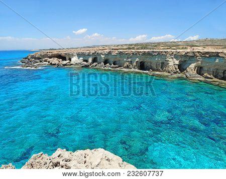Rocky Coast Caves In The Mediterranean Sea Landscape On Cyprus Island