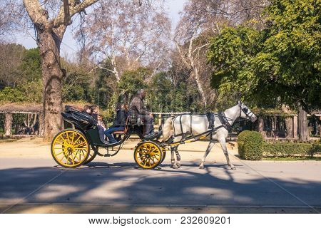 Sevilla, Spain. February 2018: Old Horse Drawn Carriage At Seville Street. Sevilla Carriage Tours Ar