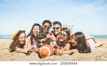 Group Of Multiracial Happy Friends Having Fun Playing Sport Beach Games - International Concept Of S