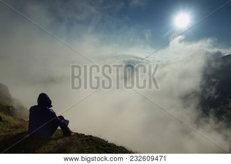 Man On The Peak Of Mountains At Sunrise - Meditation. Majestic View Of Mountains At Sunrise. Mountai