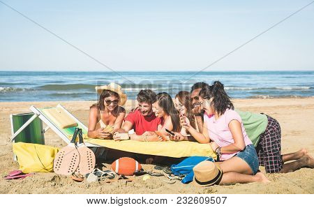 Group Of Multiracial Friends Having Fun Together With Smartphone - Young People Social Networking Wi