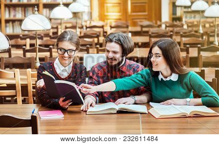 Engaged Students Checking Information In Different Booksources, Two Lovely Girl Wearing Cool Glasses