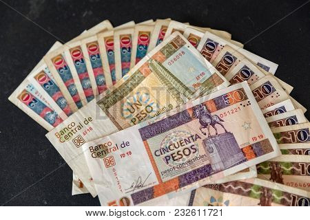 Cuban Convertible Pesos (cuc) On The Table. Cuban Convertible Banknotes And Coins