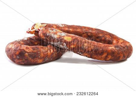 Iberian Red Spanish Chorizos With Their Distinctive Smokiness And Deep Red Color. Isolated Over Whit