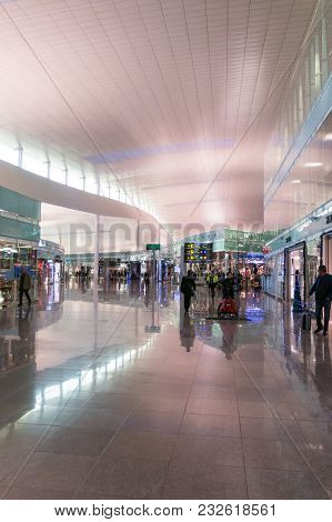 Passengers With Luggage In Barcelona International Airport El Prat Interior . Airport Is One Of The