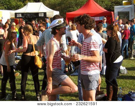Two Guys At A Gay Pride Party In A Park In Prague In The Summer Of 2014.