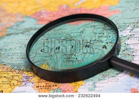 Map Of China Through Magnifying Glass On A World Map