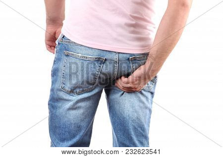 Man In Jeans Scratching Hand His Itchy Bottom
