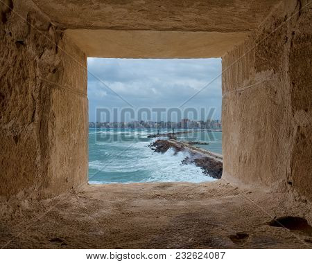Stone Window Frame Overlooking Barrier And Entrance Of The Old East Harbor Of Alexandria City At The