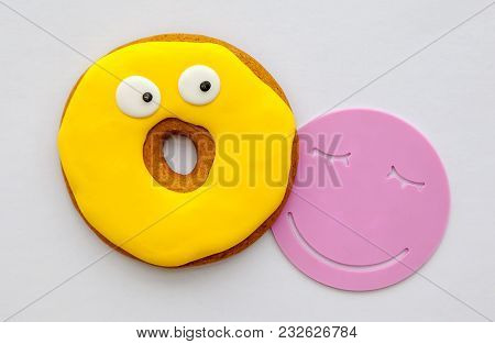 Yellow Bright Biscuits In The Glaze And Stand For A Cup In The Form Of A Smile.