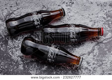 London, Uk -march 22, 2018: Glass Bottles Of Classic Coca Cola Soda Drink With Diet And Zero Cola On