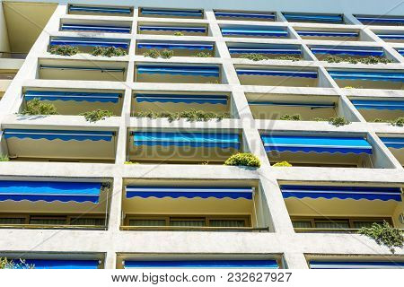 Modern Hotel Apartment Facade With Many Balconies. Texture Pattern Architecture.
