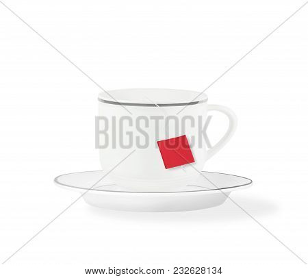 Side View Of Teabag Brewing In Tea Cup On Saucer Isolated On White Background
