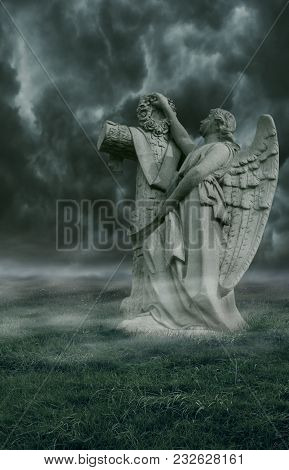 A Gothic Background Of Fog, Grass And An Angel Statue With Storm Skies.