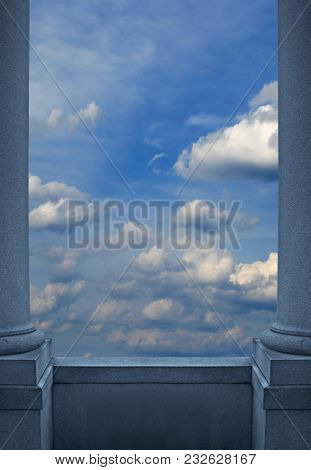 A Background Of Pillars With A Balcony Overlooking A Sky Filled With Puffy Clouds.