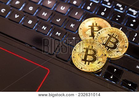 Conceptual Cryptocurrency Bitcoin On Computer Keyboard