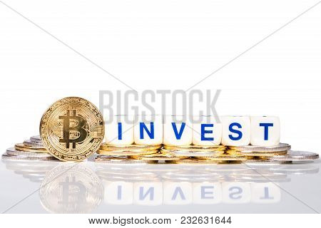 Conceptual Cryptocurrency Bitcoin With The Word Invest