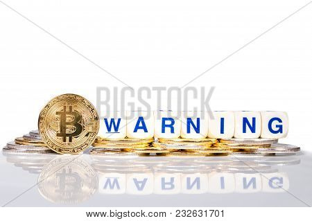 Conceptual Cryptocurrency Bitcoin With The Word Warning