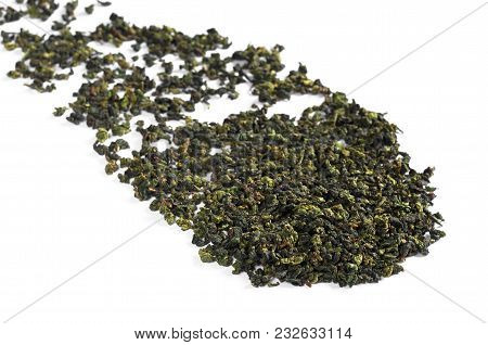 Dry Green Tea Leaves Scattered On A White Background. Tie Guan Yin. Selective Focus