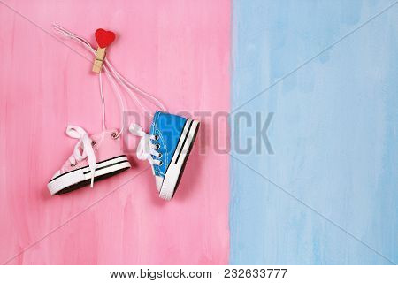 Baby Sneakers On Pink And Blue Background, Boy Or Girl Concept, Copy Space