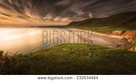 Sunset At Rhossili Bay On The Gower Peninsula, Swansea, South Wales, Uk, Voted One Of The Top Ten Be