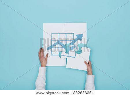 Woman Completing A Puzzle With A Graph Icon