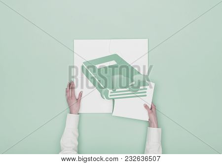 Woman Completing A Puzzle With Book Icon