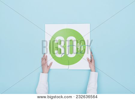 Woman Completing A Puzzle With A 30% Off Discount Icon