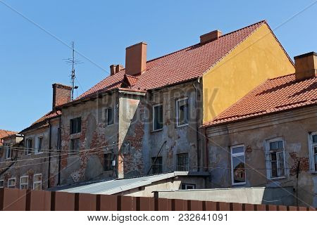 View Of The Old German Shabby Buildings In Pravdinsk (prior Friedland), Russia. Pravdinsk Was Founde