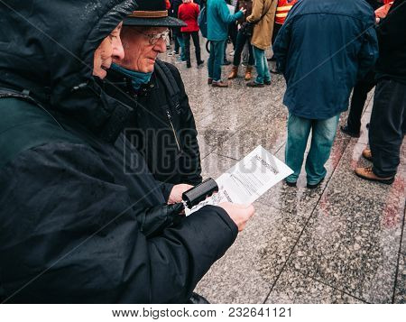 Strasbourg, France  - Mar 22, 2018: Senior Couple Reading Manifest Flyer At Demonstration Protest Ag