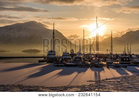 Sunrise In A Small Port With Boats In Lofoten, Norway